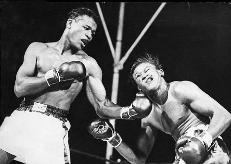 Cuban welterweight Kid GavilanÕs face is distorted as Sugar Ray Robinson connects with a terrific left to the jaw. Many aficionados think Robinson is the best pound-for-pound fighter of all time. Even Muhammad Ali believes Sugar Ray was the greatest. July 1949